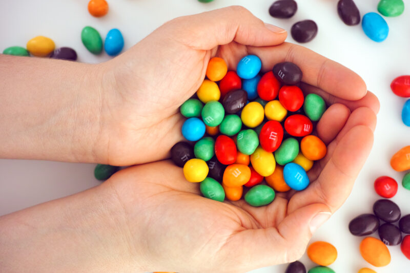 Image of hands holding M&M's