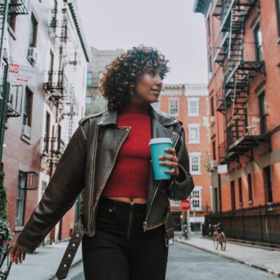 Image of woman walking through NYC.