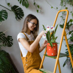 Image of woman caring for her plants