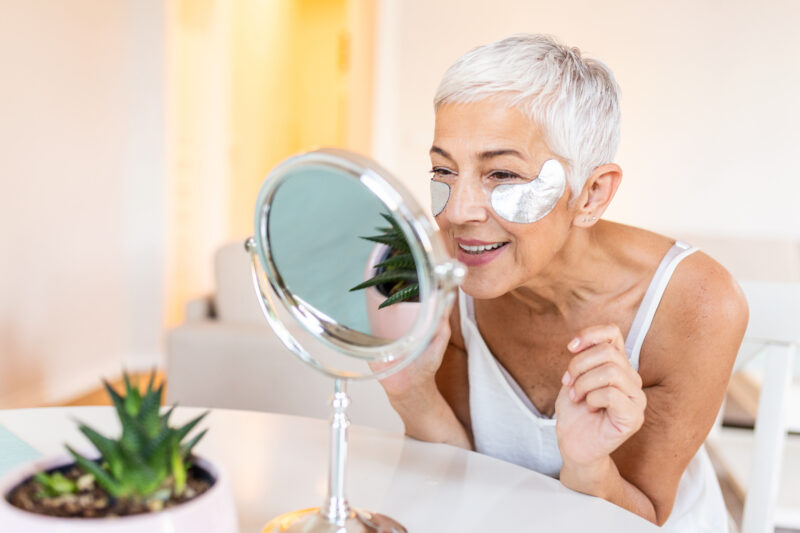 Woman with under eye masks on.