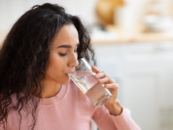 Image of woman drinking water.