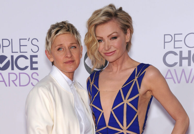 Portia de Rossi in a blue romper with Ellen DeGeneres in a white suit