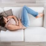 Woman sleeping in jeans.