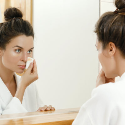 Image of woman taking off her makeup.