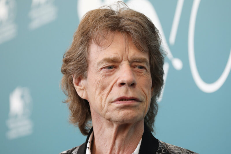 close up of Mick Jagger in a grey coat