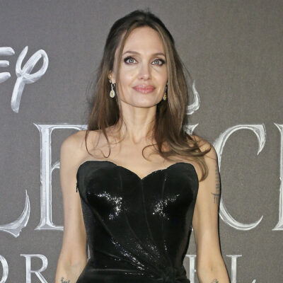 Angelina Jolie smiling in a black dress
