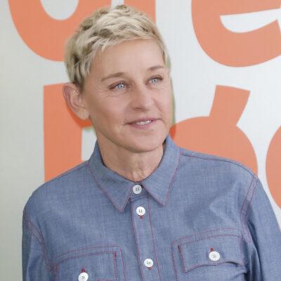 Ellen DeGeneres smiling in a blue shirt