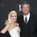 Blake Shelton in a black suit with Gwen Stefani in a white dress