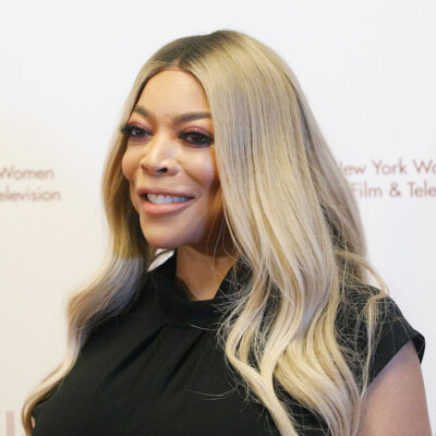 Wendy Williams smiling in a black blouse