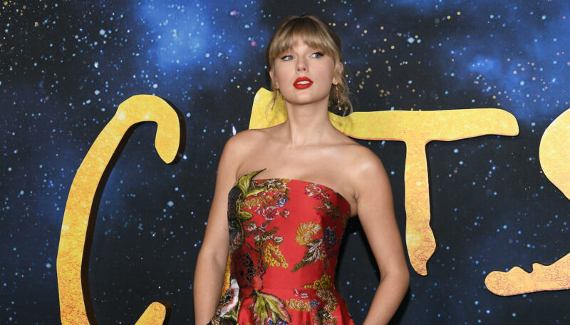 Taylor Swift in a red dress and lipstick