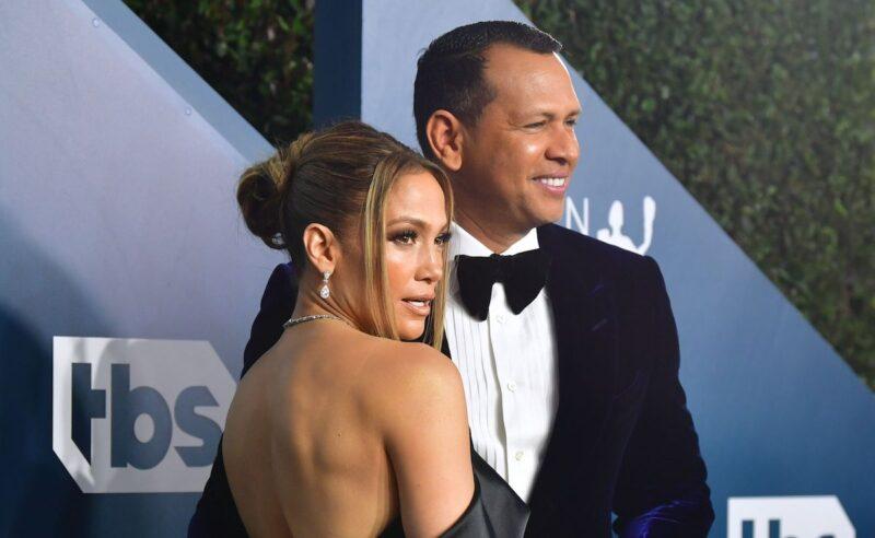 Jennifer Lopez in a blue dress with Alex Rodriguez in a tux