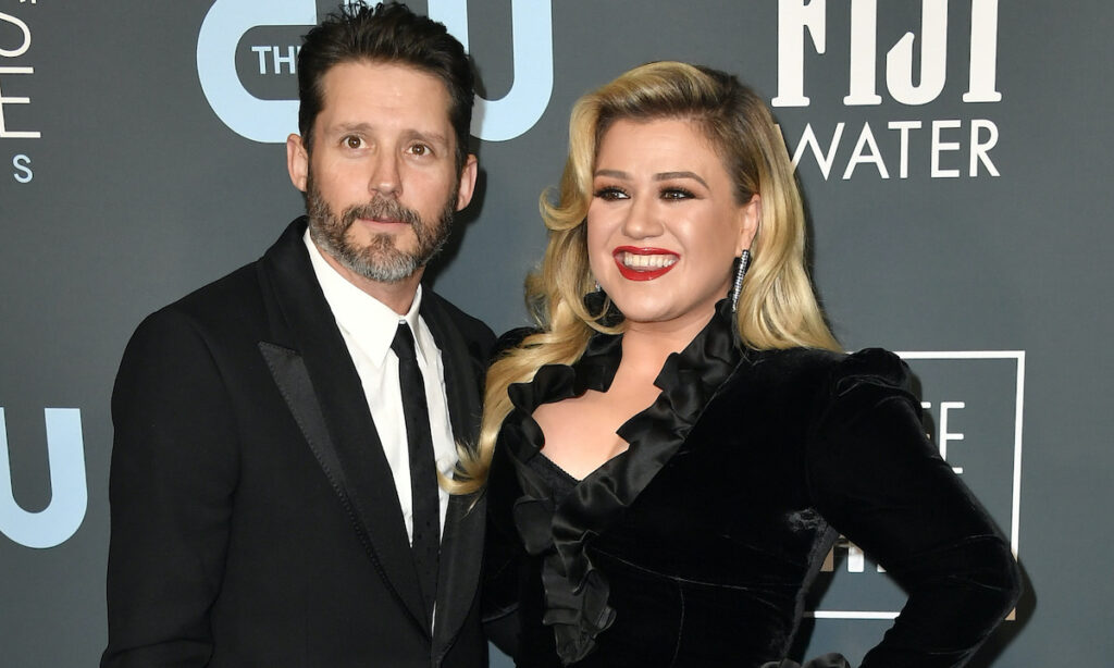Kelly Clarkson in a black dress with ex-husband Brandon Blackstock in a black suit