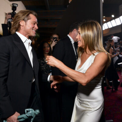 Brad Pitt and Jennifer Aniston greeting each other at the SAG Awards
