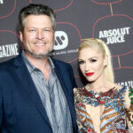 Gwen Stefani and Blake Shelton smiling together on the red carpet