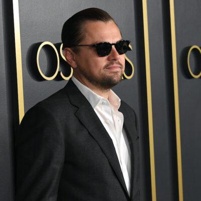 Leonardo DiCaprio in a black suit with sunglasses
