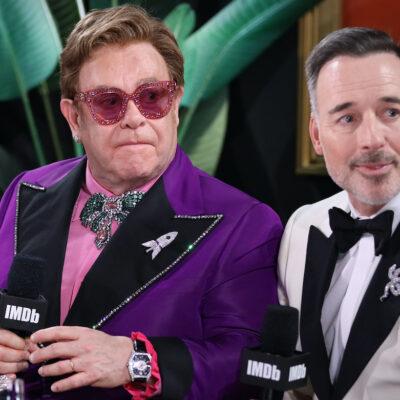 Elton John and David Furnish with IMDb in tuxedos
