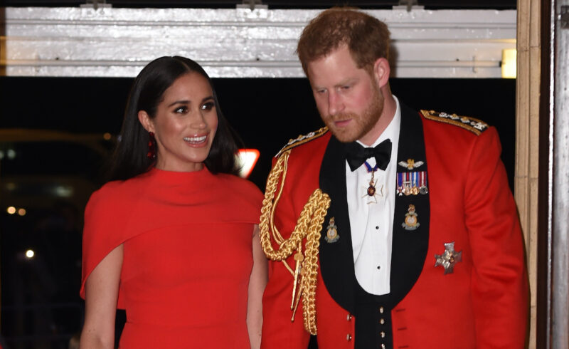 Prince Harry and Meghan Markle in red outfits