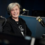 Sharon Osbourne in a black jacket during a radio interview