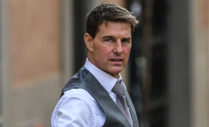 Tom Cruise in a white shirt and grey vest