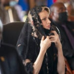 Princess Charlene of Monaco in a black outfit at the funeral of the King of the Zulu Nation