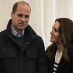 Prince William in a black coat with Kate Middleton in a black sweater