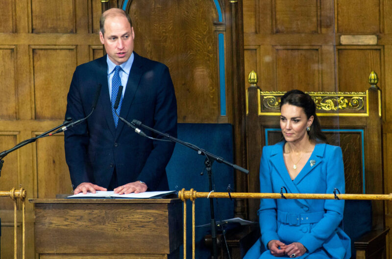Prince William in a blue suit with Kate Middleton in a blue dress in Parliament