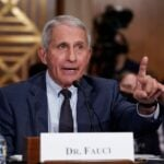 Dr. Anthony Fauci in a blue suit testifying to congress