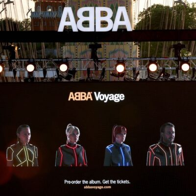 Photo of the ABBA concert stage with digital avatars of ABBA members