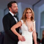Ben Affleck in a tux with a hand on Jennifer Lopez's hip