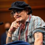 Johnny Depp in a plaid shirt and black hat