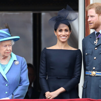 Queen Elizabeth, Meghan Markle, and Prince Harry on a balcony together