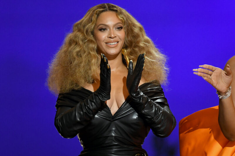 Beyonce in a black outfit clapping on stage