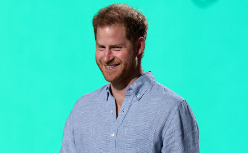 Prince Harry in a blue shirt smiling