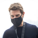close up of Tom Cruise in a black sweater and mask