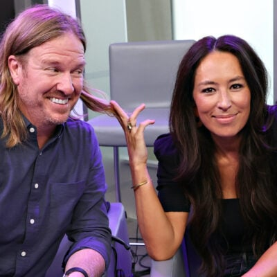 Chip and Joanna Gaines smiling at SiriusXM's stage