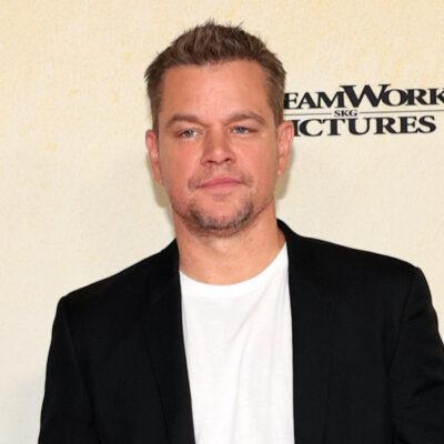 Matt Damon in a black jacket and white shirt