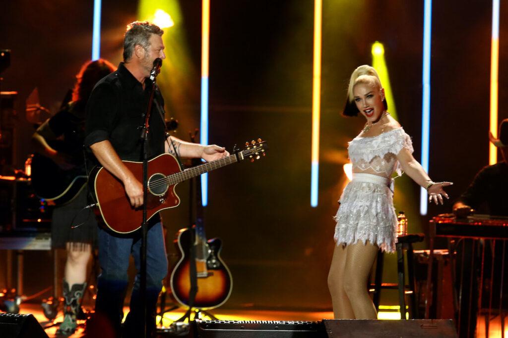 Gwen Stefani and Blake Shelton performing on stage together