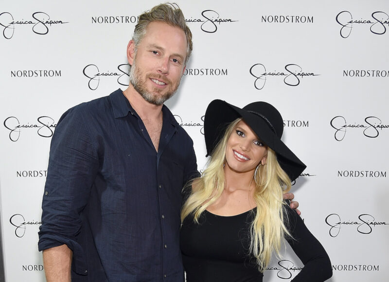 Jessica Simpson in a black dress with Eric Johnson in a blue shirt in 2014