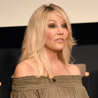 Heather Locklear in a green blouse