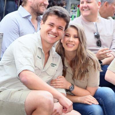 Bindi Irwin and Chandler Powell in khaki smiling together