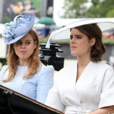 Princesses Beatrice and Eugenie riding in a carriage together