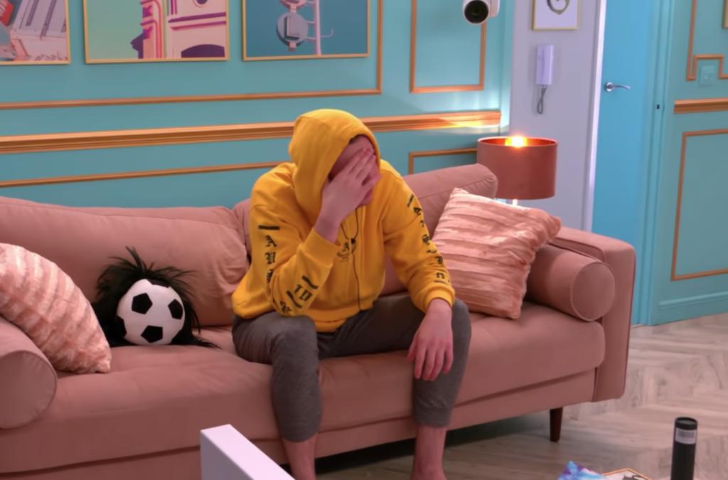 Jack (aka Emily) wearing a yellow hoodie on Netflix's 'The Circle'