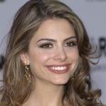 Maria Menounos wears a formal gown on the red carpet