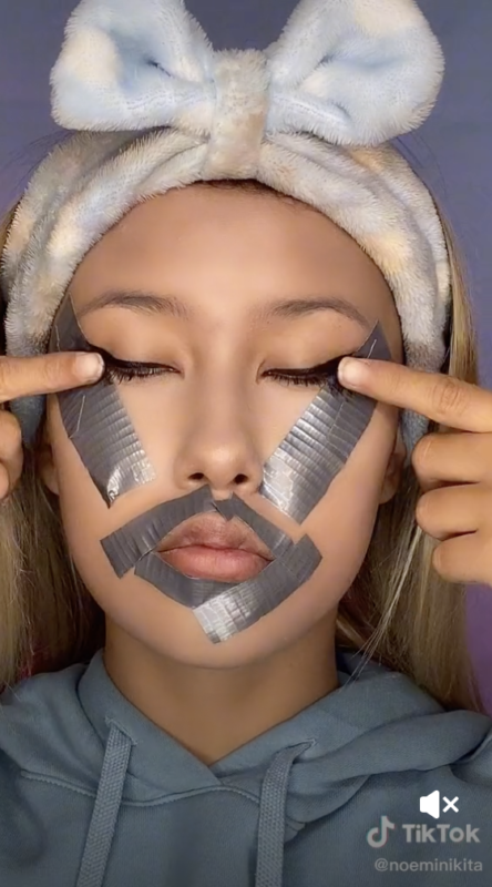 Image of girl with duct tape and makeup