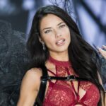 Adriana Lima wears a red bra and black wings on the catwalk