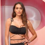Amelia Hamlin wears a black top and skirt on the red carpet