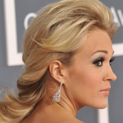Carrie Underwood wears a white dress on the red carpet