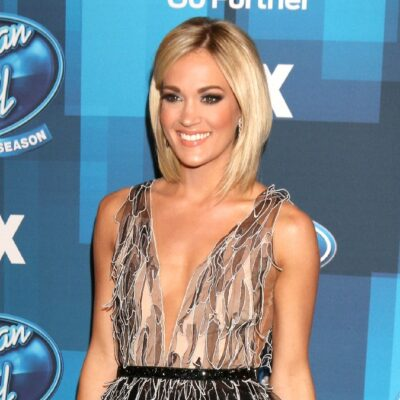 Carrie Underwood wears a sheer dress on the red carpet