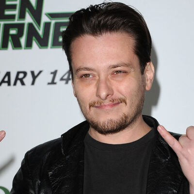 Edward Furlong making a gesture with his hands.
