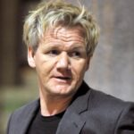 Gordon Ramsay wears a dark suit jacket at LAX airport